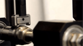 Self leveling block holder for block-on-ring tester